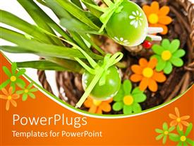 PowerPlugs: PowerPoint template with flowers and green plants tied to easter eggs in orange background