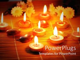 PowerPlugs: PowerPoint template with flowers, pebbles, and burning tea light candles arranged on bamboo mat