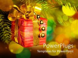 PowerPlugs: PowerPoint template with gift box with golden ribbon and round ornaments hand from Christmas tree