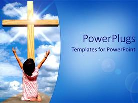 PowerPoint template displaying a girl praying in front of a holy cross and bluish background