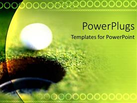 PowerPoint template displaying a golf ball just going in the hole with greenery in the background
