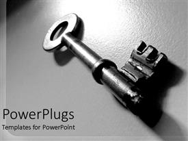 PowerPlugs: PowerPoint template with gray metallic key close up on gray shiny background