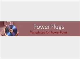 PowerPlugs: PowerPoint template with a grayish background with a person holding the cd in his hand