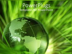 PowerPlugs: PowerPoint template with a green colored earth globe on a pile of green grass