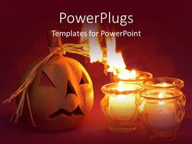 PowerPlugs: PowerPoint template with halloween jack o lantern, burning candles, orange background