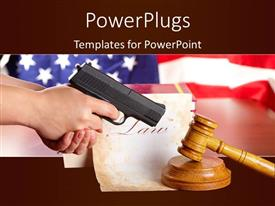 PowerPoint template displaying hand with gun aiming at judges wooden gavel with gun and very old paper with US flag in the background