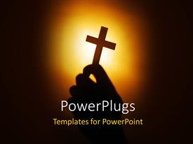 PowerPoint template displaying hand holding cross over with light glow in background