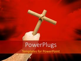 PowerPlugs: PowerPoint template with hand holding crucifix over red background