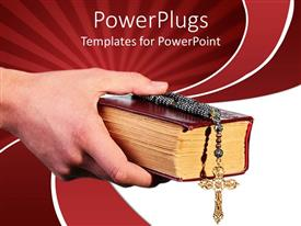 PowerPoint template displaying a hand holding the holy cross and holy bible
