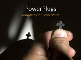 PowerPoint template displaying hand holding metal cross with shadow in background