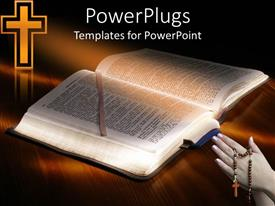 PowerPoint template displaying a hand holding a rosary with a Bible and a cross