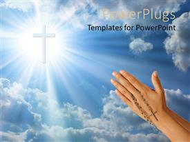 PowerPlugs: PowerPoint template with a hand holding a rosary with a cross in the sky