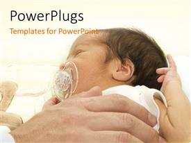 PowerPlugs: PowerPoint template with a hand holding a small baby with a sucker