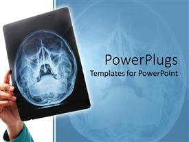 PowerPlugs: PowerPoint template with hand holding up X-ray scan of human skull for examination
