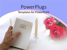 PowerPlugs: PowerPoint template with hand holds Holy Bible between two burning candles with rose in background