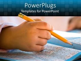 PowerPlugs: PowerPoint template with hands of a child holding yellow pencil over crossword magazine