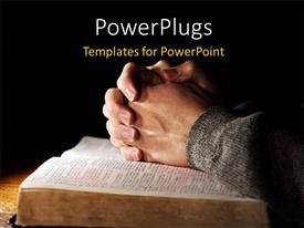 PowerPlugs: PowerPoint template with hands of a man praying in solitude with his Bible and black color