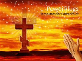PowerPoint template displaying hands praying with rosary beads to Christian cross with sunset star background