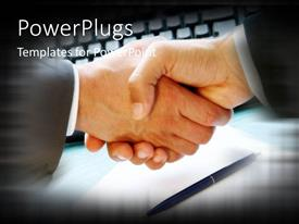 PowerPlugs: PowerPoint template with handshake signifying business agreement with pen over paper and computer keyboard