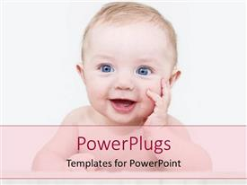 PowerPoint template displaying happy baby laughing at the camera holding his hand on his face on bright background