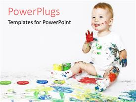 PowerPlugs: PowerPoint template with happy baby with paint on hands and face and body and painting on white floor