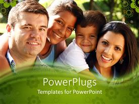PowerPoint template displaying happy family of four smiling as they pose for snapshot in park