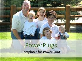 PowerPoint template displaying happy family of six in green grassland with wooden bars as fence