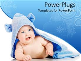PowerPoint template displaying happy smiling newborn baby covered by blue soft bath towel