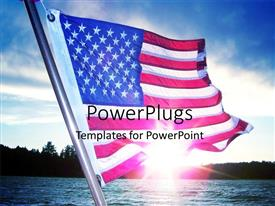 PowerPoint template displaying hoisted American flag over blue cloudy sky with sunshine reflecting on sea surface