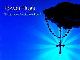 PowerPlugs: PowerPoint template with a holy cross in a hand with bluish background