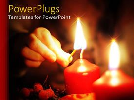 PowerPoint template displaying human hand lighting two large red candles with a match stick
