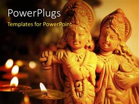 PowerPlugs: PowerPoint template with an idol of a Hindu God Krishna and Radha with lighted candles
