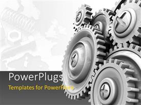PowerPoint template displaying industral theme with gear wheels and tools in the background