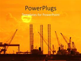 PowerPoint template displaying industrial plants with cranes and sunset on horizon