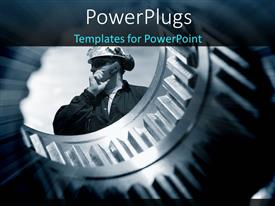 PowerPoint template displaying internal view of a large gear wheel with an engineer