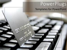 PowerPoint template displaying a keyboard and a credit card with blurr background