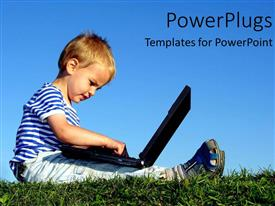 PowerPoint template displaying a kid playing with the laptop with a bluish background