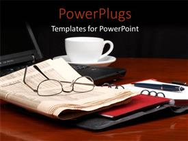 PowerPlugs: PowerPoint template with a laptop with a pair of reading glasses on a newspaper