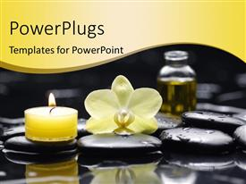 PowerPlugs: PowerPoint template with lighted yellow candle and oil with water droplets on spa stones
