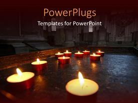 PowerPlugs: PowerPoint template with a lot of candles being burnt with a church in background