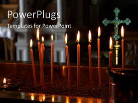 PowerPoint template displaying a lot of candles with a cross in the background