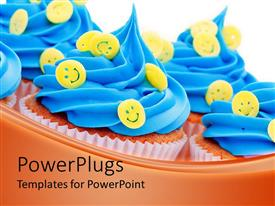PowerPlugs: PowerPoint template with lots of queen cup cakes with blue icing and yellow smiley faces