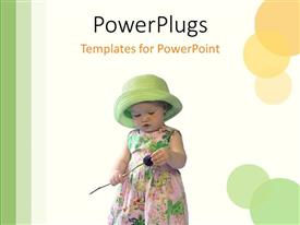 PowerPoint template displaying lovely young child with a green hat holding an object