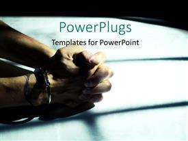 PowerPoint template displaying male cuffed hands over dirty white table lit through the cell bars with harsh light