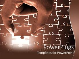 PowerPlugs: PowerPoint template with male hand lowering final puzzle piece into illuminated jigsaw puzzle, problem solving metaphor