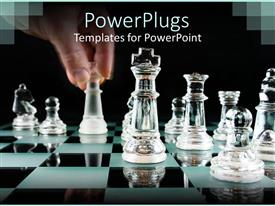 PowerPlugs: PowerPoint template with man hand moving chess piece on reflective chess table with glassy chess pieces