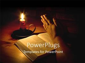 PowerPlugs: PowerPoint template with man praying next to bible with candle