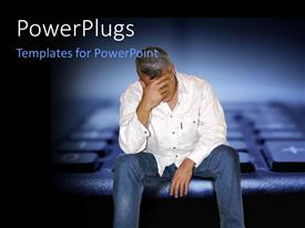 PowerPoint template displaying man sitting depressed with financial problems with keyboard