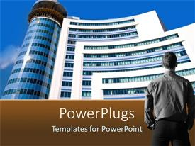PowerPlugs: PowerPoint template with man standing in front of tall building rising to blue sky