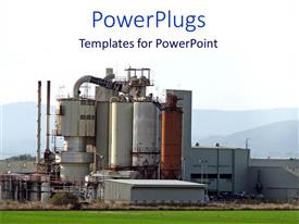 PowerPlugs: PowerPoint template with manufacturing facility on green grass with mountains, industrial factory